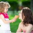 Woman and child in spring park — Stock Photo #9152119