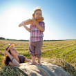 Happy woman and child in wheat field — Stock Photo