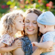 Happy woman with child and baby — Stock Photo #9152157