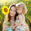 Woman and child with sunflower — Stock Photo #9152172