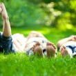 Happy children lying on green grass — Foto Stock #9152187