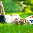 Happy children lying on green grass — Stock fotografie #9152187