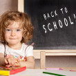 Smiling schoolchild in a class — Stock Photo #9152277