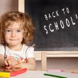 Stock Photo: Smiling schoolchild in a class