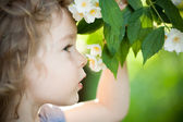 Child with jasmin flower — Stock Photo