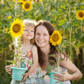 Woman and child with sunflower — Stock Photo