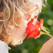 Child with flower — Stock Photo #9341241