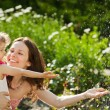 Woman with child playing in spring park — Stock Photo #9341250