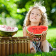 Child having picnic in spring park — Stock Photo #9341260