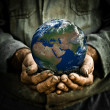 Man holding Earth — Stock Photo