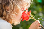 Child with flower — Stock Photo
