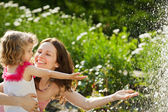 Woman with child playing in spring park — Stock Photo