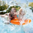 Child with father in swimming pool - Stock Photo