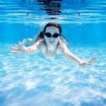 Woman swimming underwater — Stock Photo #9494321