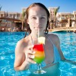 Woman drinking a fruit cocktail — Stock Photo