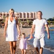 Royalty-Free Stock Photo: Happy family walking at the beach