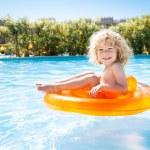 Happy kid swimming in pool — Stock Photo #9716351