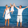Happy family playing at the beach — Stock Photo #9716354