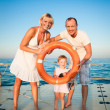 Happy family playing at the beach — Stock Photo #9716364