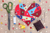 Sewing accessories and fabric scraps heart — Stock Photo