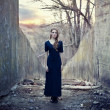 Beautiful lonely girl in long dress — Stockfoto