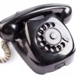 Old black phone on white background — Stock Photo