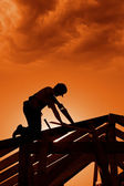 Stormy sunset on construction site — Stock Photo