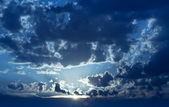 Dawning under the dissolving clouds blanket — Stock Photo