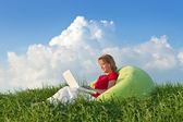 Woman with laptop computer outdoors — Stock Photo