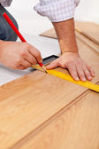 Measuring laminate flooring plancks — Stock Photo