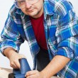 Stock Photo: Carpenter or joiner working with electric planer