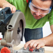 Foto Stock: Carpenter or joiner working with power tool