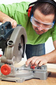 Carpenter or joiner working with power tool — Stock Photo