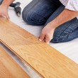 Installing laminate flooring — Stock Photo