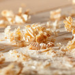 Wooden shavings on the workbench — Stock Photo