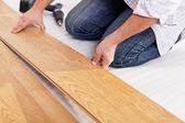 Installing laminate flooring — Stock Photo