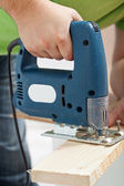 Carpenter or joiner working with electric saw — Stock Photo