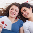 Girls having fun reading love letter together — Stock Photo