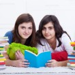 Tutoring concept - girls learning together — Stock Photo
