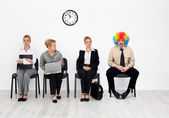 There's one in every crowd - clown among job candidates — Stock Photo