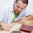 Man furbishing wooden planck — Stock Photo