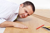 Laying laminate flooring at home — Stock Photo