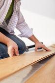 Colocação de piso laminado - closeup — Foto Stock
