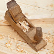 Wood plancks, plane and wooden shavings — Stok fotoğraf