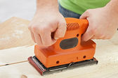 Worker hands with electric sander machine — Stock Photo