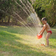 Water sprinkler fun — Stock Photo