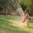 Water sprinkler fun — Stock Photo #9604329