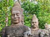 Stone faces in Angkor Wat Area — Stock Photo