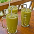 Three fresh mango milkshakes - Stockfoto