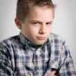 Stock Photo: Sullen boy